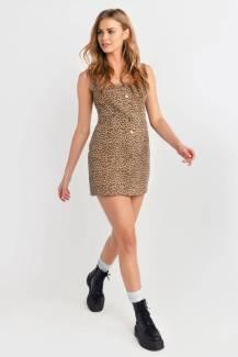 leopard-crouching-under-button-up-denim-dress